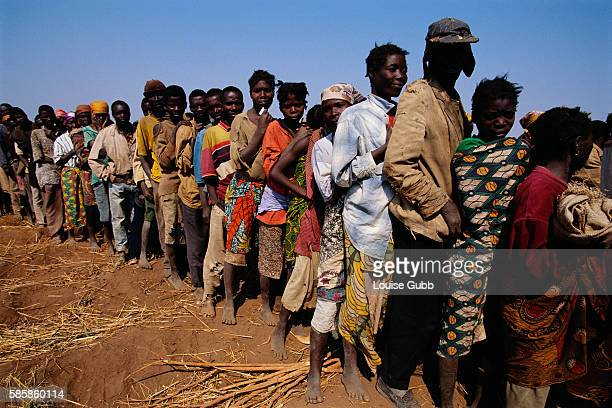 Refugees in Camacupa Angola line up to receive blankets from a Medecins sans Frontieres distribution site After Angola gained independence from...