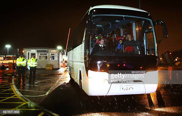 Refugees leave Glasgow Airport on buses after the first of a series of charter flights carrying refugees arrived on November 17 2015 in Glasgow...