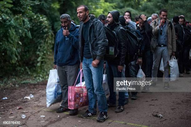 BORDER BAPSKA SYRMIA CROATIA Refugees lined up to cross the border to Croatia More and more refugees arrive in Europe seeking asylum