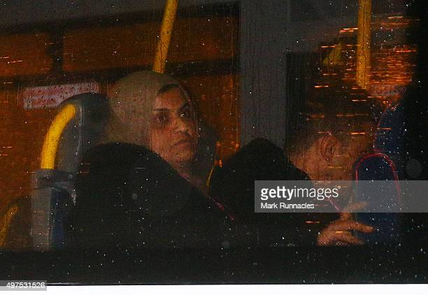 Refugees look out the window as they leave Glasgow Airport on buses after the first of a series of charter flights carrying refugees arrived on...