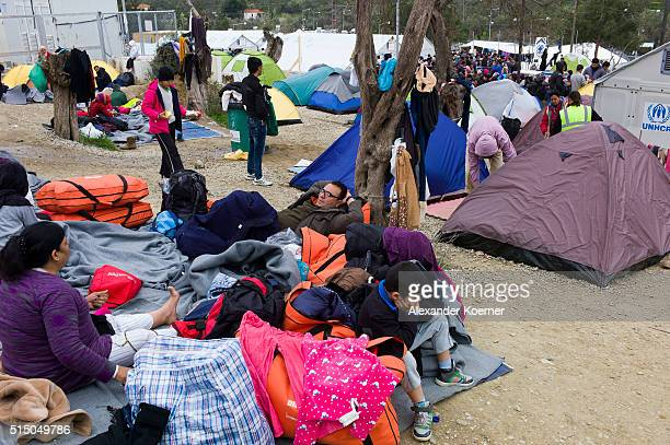Refugees mainly from Syria Iran and Iraq are seen inside a registration camp owned by the UNHCR outside the village of Moria on March 12 2016 in...