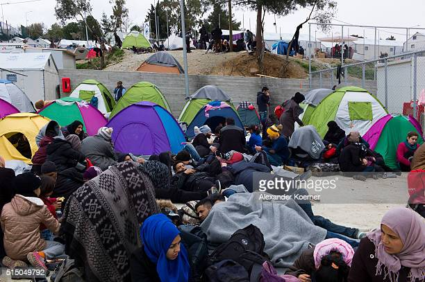 Refugees mainly from Syria Iran and Iraq are seen inside a registration camp while waiting to be registrated outside the village of Moria on March 12...