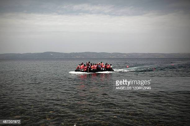 Refugees of Syria arrive aboard a dinghy on the shore of the Lesbos island on September 7 2015 Greece sent troops and police reinforcements on...
