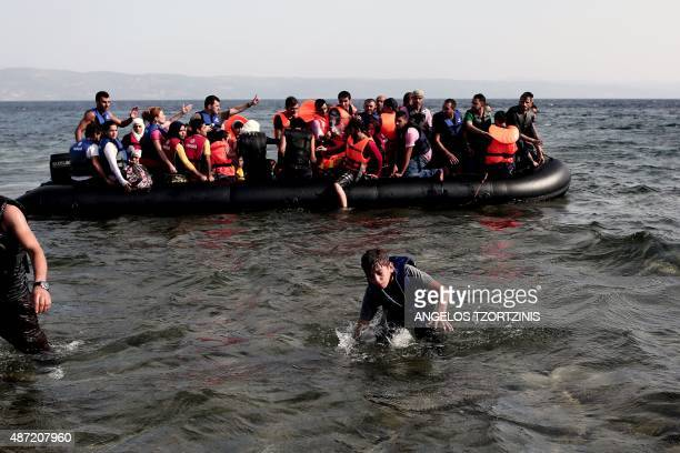 Refugees of Syria arrive on the shores of the Greek island of Lesbos aboard an inflatable dinghy across the Aegean Sea from Turkey on September 7...