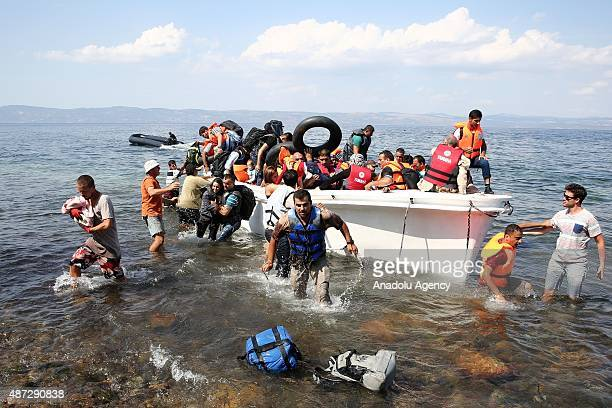 Refugees on a rubber boat reach the shore of Eftalou beach Mithymna Town after crossing the Aegean from Turkey on September 08 2015 in Lesbos Island...