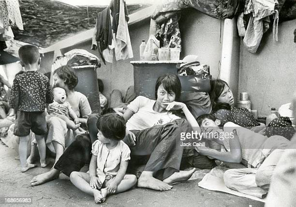 Refugees on a tiny freighter fleeing Saigon Heat in the holds was so intens that breathing became dificult