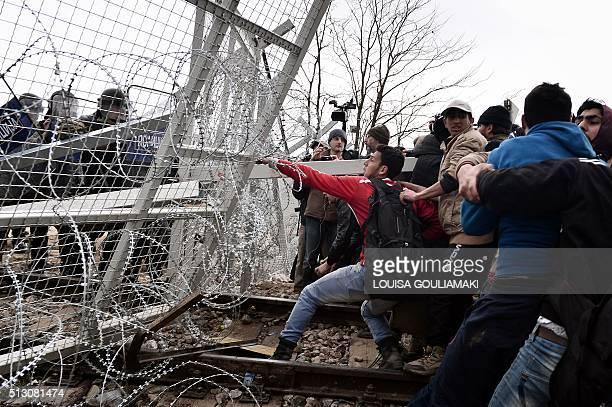 Refugees open the gate at the GreekMacedonian borders during their protest demanding the opening of the borders near the village of Idomeni on...