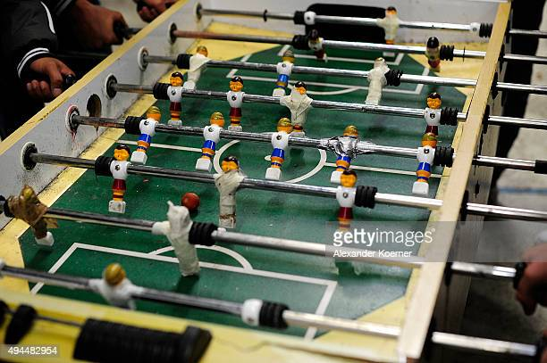 Refugees play table football inside a food distribution hall on October 27 2015 in Celle Germany Volunteers have begun to set up weatherresistant...