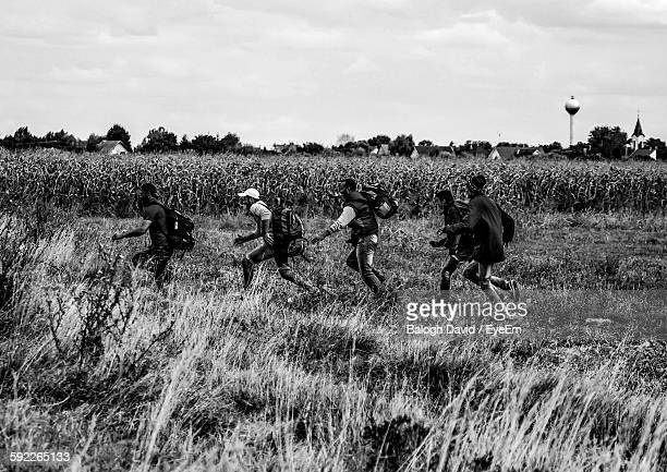 Refugees Running On Field