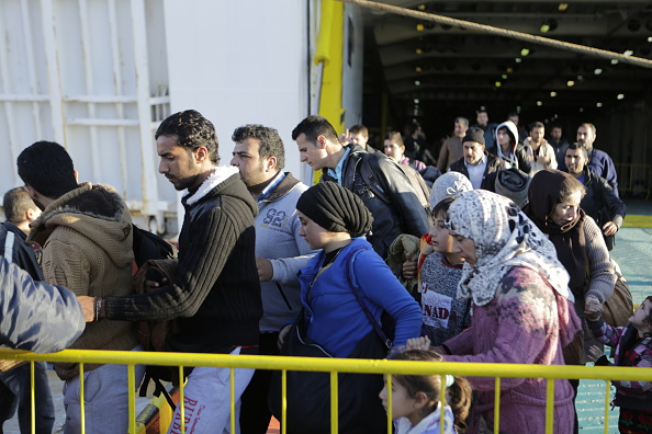 Refugees rush from the ferry EL. Venizelos after it has...