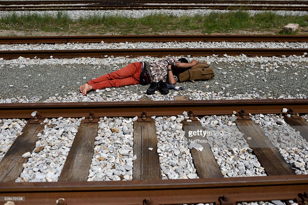 A refugees sleeps near the rails of the abandoned train station at Idomeni refugee camp on May 5'th, 2016. Thousands of migrants are still located in the makeshift refugee camp, located at the Greek Macedonian border, waiting for the border to re-open.