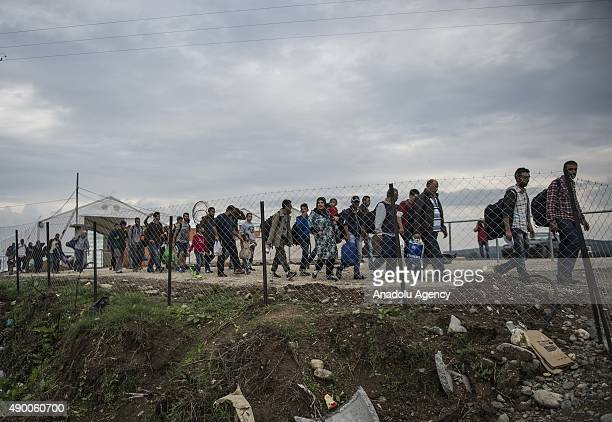 Refugees sorted into groups of 50 walk towards the GreekMacedonian border near the village of Idomeni in northern Greece on September 25 2015...