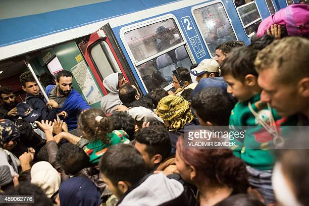 Refugees struggle to get on a train from Gyor to Hegyeshalom in Hungary on September 19 2015 During the night they were transported from the Croatian...
