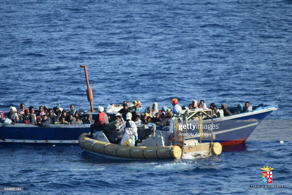 138 Refugees, trying to pass Europe, are seen on a boat at the middle of the Mediterranean Sea before Italian security forces rescued them at the Mediterranean Sea in an unspecified location on May 23, 2016.