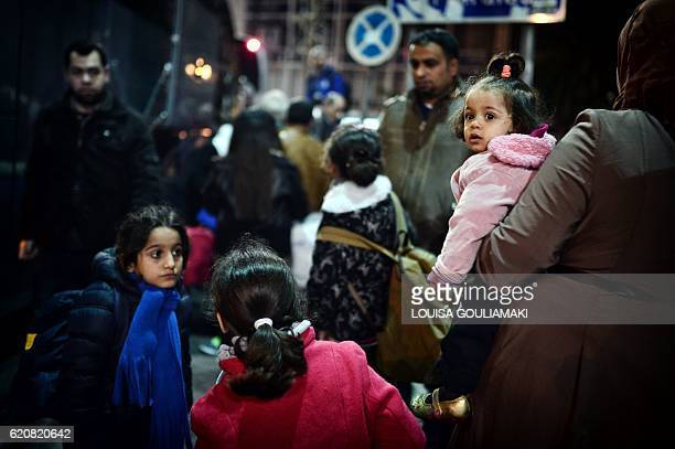 Refugees wait for a bus heading to the airport in Athens to take a special charter flight bound for France in the frames of the EU relocation program...