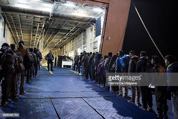 Refugees wait for boarding ferry boats to Athen at Mytilini port Refugees from Afghanistan and Syria arrive in boats on the shores of Lesbos near...