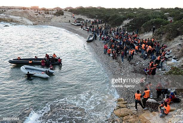 Refugees wait for their turn to get on an inflatable boat before they set off on a journey to Greece's Chios Island from the Cesme District of Izmir...