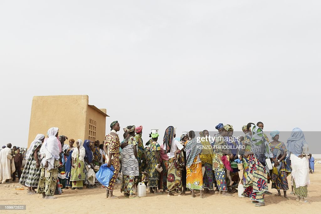 Refugees wait on January 24, 2013 at a refugee camp set in Menteao near the Malian border. The conflict in Mali has caused nearly 150,000 people to flee the country, while about another 230,000 are internally displaced, the UN humanitarian agency said on January 15, 2013. According to OCHA, the UN High Commissioner for Refugees has registered 144,500 refugees in neighbouring countries -- 54,100 in Mauritania, 50,000 in Niger, 38,800 in Burkina Faso and 1,500 in Algeria.