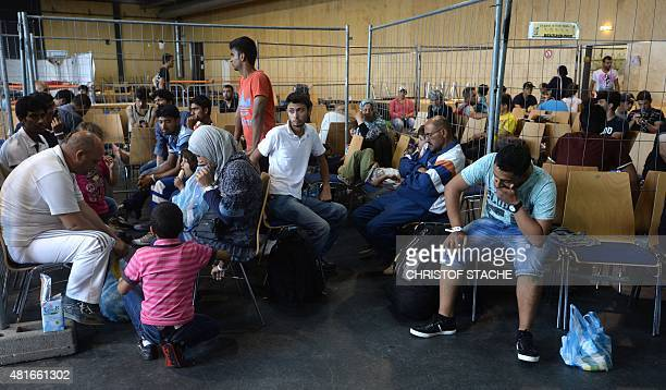 Refugees wait to be processed at the first registration point of the German federation police in Passau southern Germany on July 23 2015 Hundreds of...