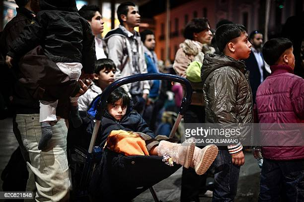 Refugees wait to board a bus on their way to the airport in Athens to take a special charter flight bound for France in the frames of the EU...
