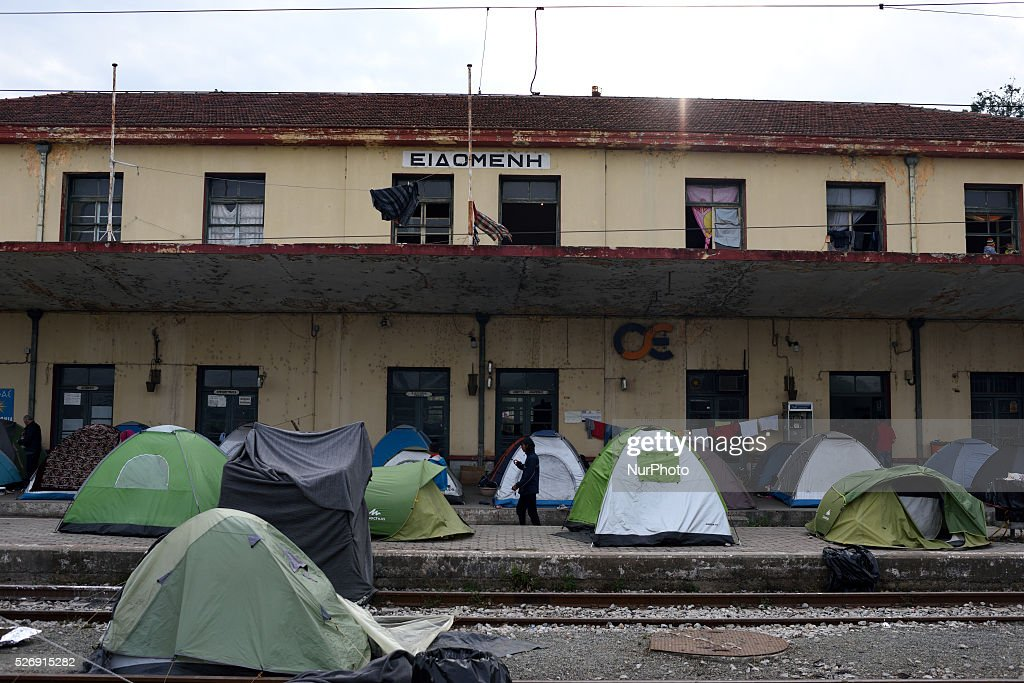A refugees walks near the dock of old Idomeni train station, as tents are located on the dock and on the rails on May 1'st, 2016 in Idomeni refugee camp. Humanitarian conditions in the camp are deteriorating as many thousands of migrants are still located in the makeshift refugee camp, located at the Greece-Macedonia border, waiting for the border to re-open.