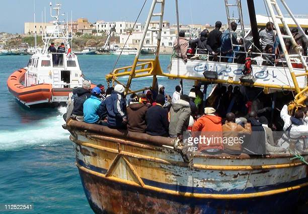 Refugees who flew Libya arrive on a boat on the Italian island of Lampedusa on April 19 2011 760 people were aboard a 20meter boat arriving from...