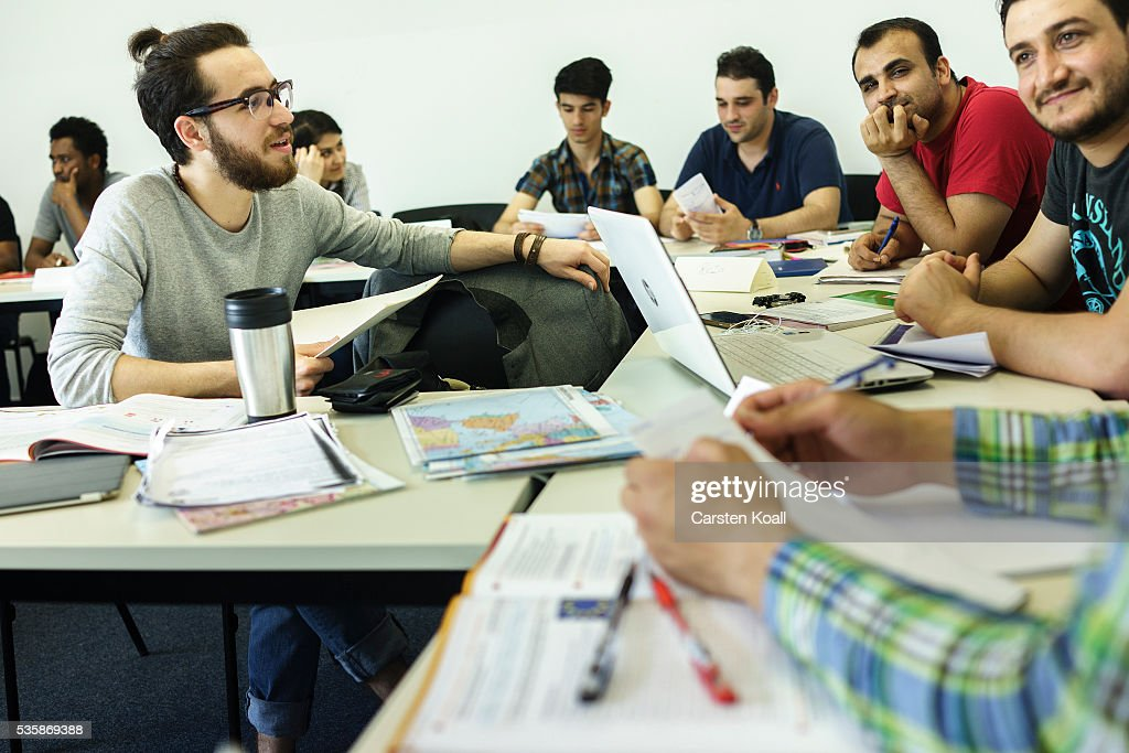 Refugees who have received asylum status in Germany attend a class to help them prepare for a study program at the Freie Universitaet Berlin, or Free University, on May 30, 2016 in Berlin, Germany. The program is intended to help refugees, especially those with university backgrounds from their home countries, to qualify for a German university education.