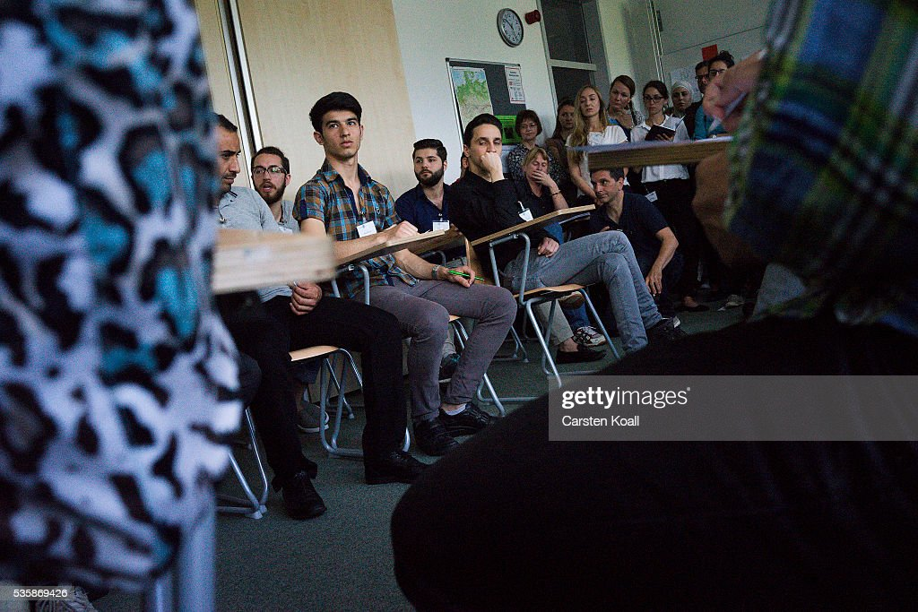 Refugees who have received asylum status in Germany attend a panel discussion about classes to help them prepare for a study program at the Freie Universitaet Berlin, or Free University, on May 30, 2016 in Berlin, Germany. The program is intended to help refugees, especially those with university backgrounds from their home countries, to qualify for a German university education.