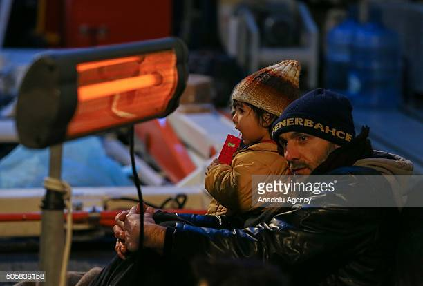 Refugees who were trying to go to Greek Islands get warm in the ship after being caught by the TCSG 'Guven' Ship belonging to the Turkish Coast Guard...