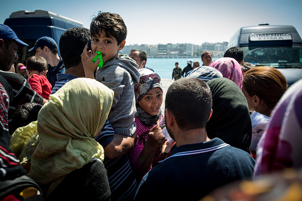Pireaus Harbour, Migrants going to official camp