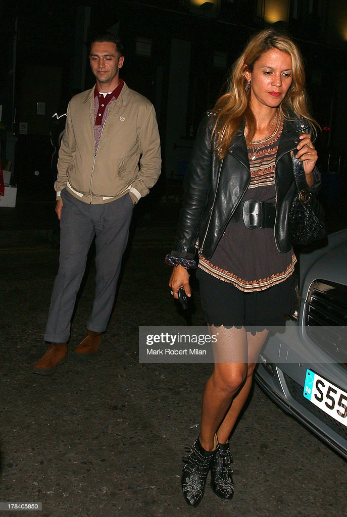 Reg Traviss and Lisa Moorish leaving the Groucho club on August 29, 2013 in London, England.