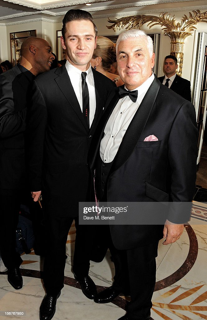 Reg Traviss (L) and Mitch Winehouse attend a drinks reception at the Amy Winehouse Foundation Ball held at The Dorchester on November 20, 2012 in London, England.