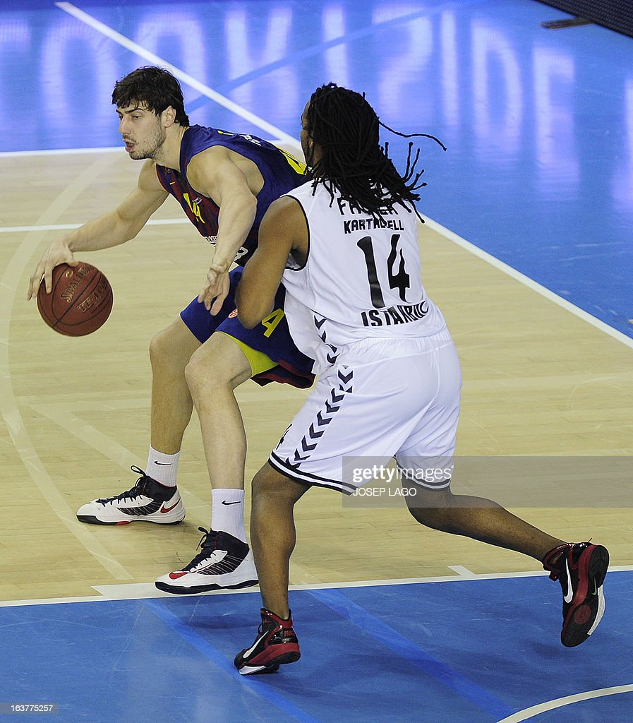 Regal Barcelona's Croatian centre Ante Tomic (L) vies with Besiktas JK Istanbul's US forward Randal Falker during the Euroleague basketball match FC Barcelona Regal vs Besiktas JK Istanbul at the Palau Blaugrana sportshall in Barcelona on March 15, 2013.