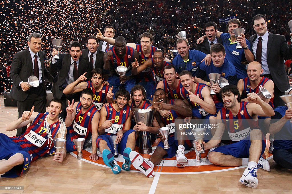 Regal Barcelona's players celebrate with their trophy after winning the Euroleague basketball final match against Olympiacos in Paris-Bercy Omnisport stadium in Paris on May 9, 2010.