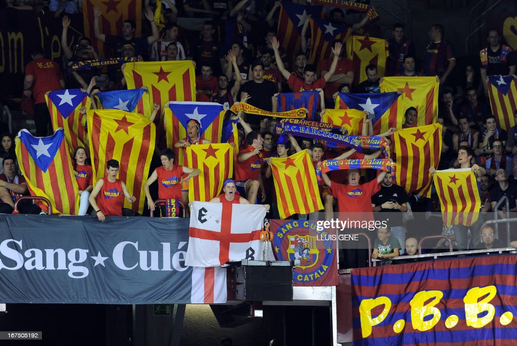 Regal FC Barcelona's supporters display independentist flags as they celebrate their team's victory and qualification for the Final Four at the end of a Euroleague basketball playoffs match Regal FC Barcelona vs Panathinaikos at the Palau Blaugrana hall in Barcelona on April 25, 2013. Barcelona won 64-53 and 3 games to 2.