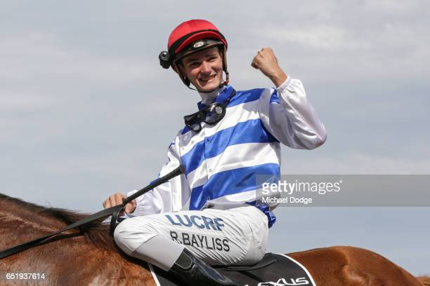Regan Bayliss celebrates after winning the Lexus Newmarket Handicap at Flemington Racecourse on March 11 2017 in Flemington Australia