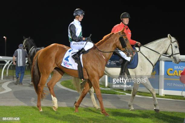 Regan Bayliss returns to the mounting yard on Serveur after winning Racingcom 3YO Maiden Plate at Racingcom Park Synthetic Racecourse on May 18 2017...