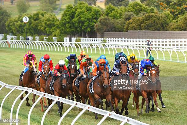 Regan Bayliss riding Decision Time sits behind the leaders before winning Race 6 at Flemington Racecourse on December 17 2016 in Melbourne Australia