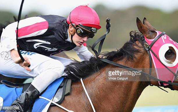Regan Bayliss riding Del Prado wins Race 8 during Melbourne Racing at Sandown Racecourse on December 5 2015 in Melbourne Australia