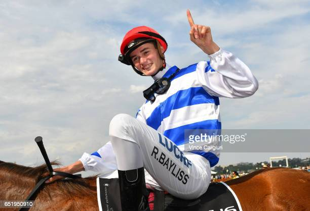Regan Bayliss riding Redkirk Warrior after winning Race 7 Lexus Newmarket Handicap during Melbourne Racing at Flemington Racecourse on March 11 2017...
