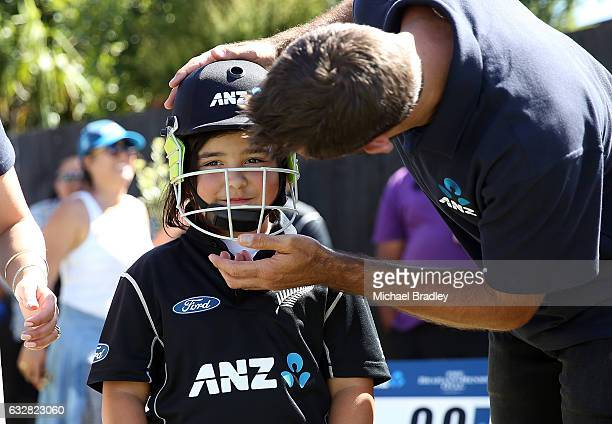 Regan BrabantHebry gets geared up with the help of Grant Elliot after she and her brother cricket fan Christopher BrabantHenry aged 14 from Mangere...