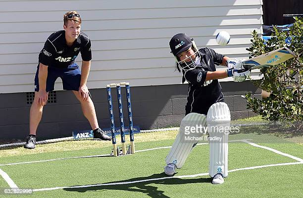 Regan BrabantHenry aged 7 plays a shot watched on by Black Caps Jimmy Neesham after cricket fan Christopher BrabantHenry aged 14 and his sister Regan...