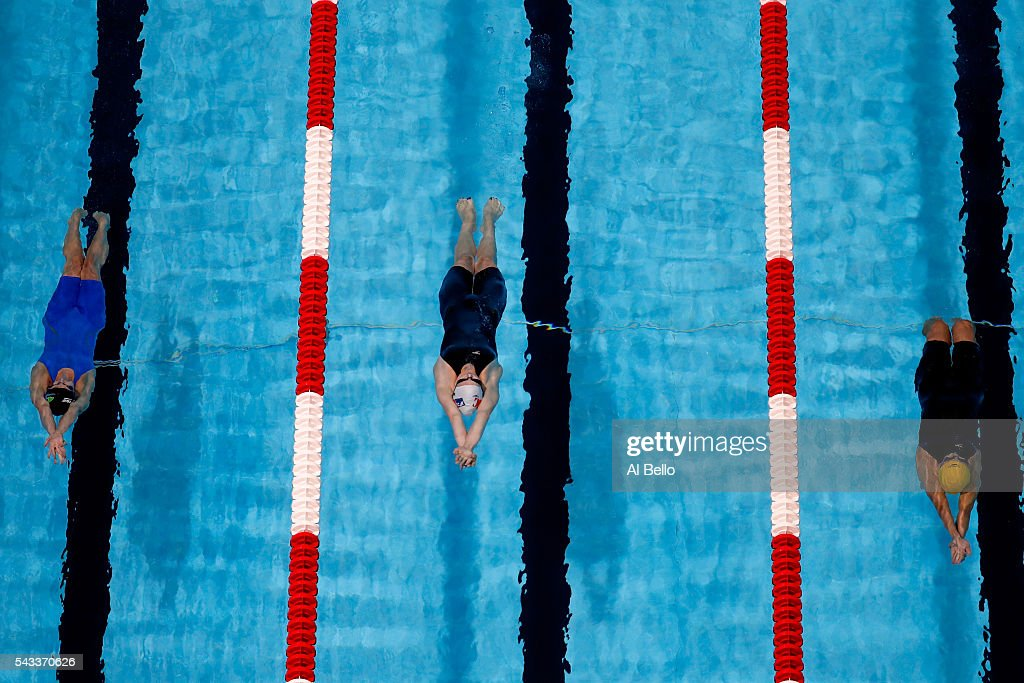 <a gi-track='captionPersonalityLinkClicked' href=/galleries/search?phrase=Regan+Smith&family=editorial&specificpeople=564271 ng-click='$event.stopPropagation()'>Regan Smith</a>, Alex Walsh and Rachel Bootsma of the United States compete in a heat for the Women's 100 Meter Backstroke during Day Two of the 2016 U.S. Olympic Team Swimming Trials at CenturyLink Center on June 27, 2016 in Omaha, Nebraska.
