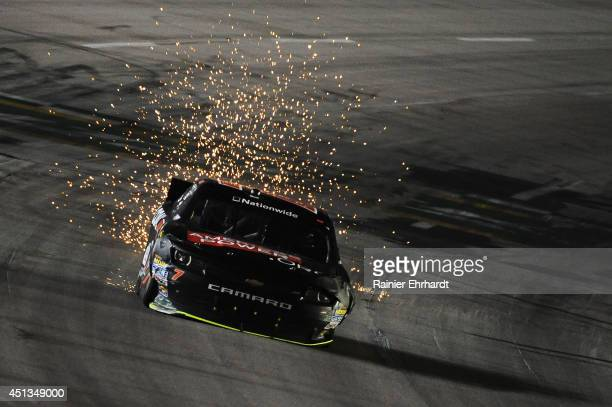 Regan Smith driver of the AmericasPowerorg Chevrolet races during the NASCAR Nationwide Series John R Elliott HERO Campaign 300 at Kentucky Speedway...