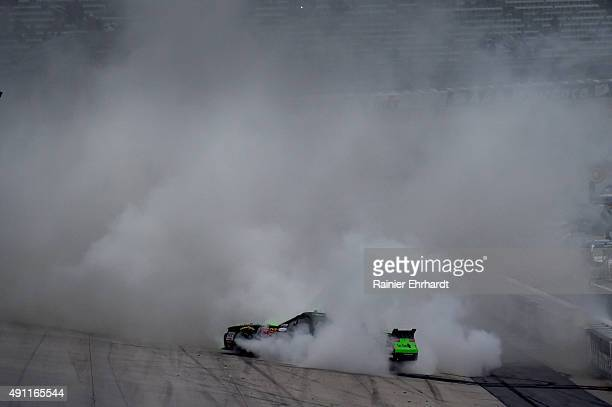 Regan Smith driver of the Fire Alarm Services Chevrolet celebrates with a burnout after winning the NASCAR XFINITY Series Hisense 200 at Dover...