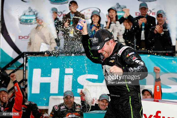 Regan Smith driver of the Fire Alarm Services Chevrolet celebrates in Victory LanVictory Laneafter winning the NASCAR XFINITY Series Hisense 200 at...