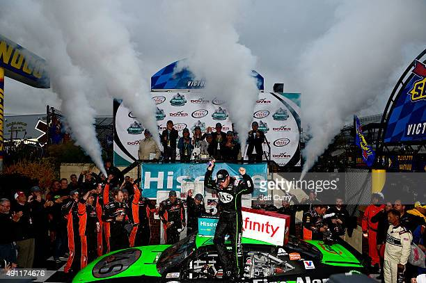 Regan Smith driver of the Fire Alarm Services Chevrolet celebrates in Victory Lane after winning the NASCAR XFINITY Series Hisense 200 at Dover...