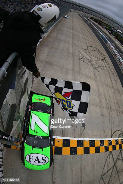 Regan Smith driver of the Fire Alarm Services Chevrolet takes the checkered flag to win the NASCAR XFINITY Series Hisense 200 at Dover International...