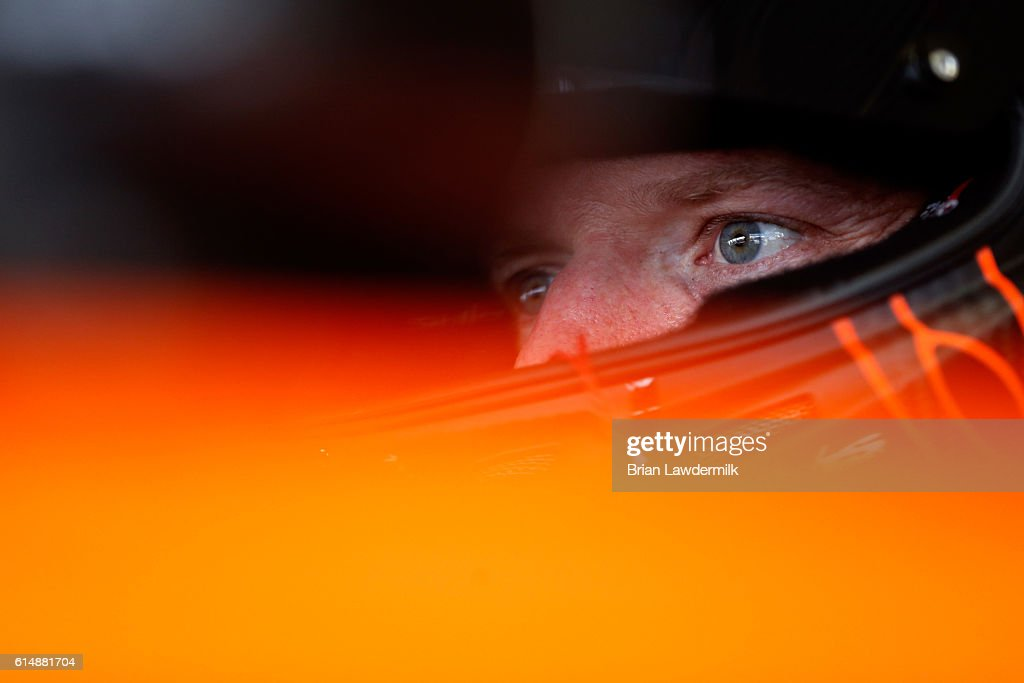 Regan Smith, driver of the #7 Fire Alarm Services Inc. Chevrolet, sits in his car during practice for the NASCAR Sprint Cup Series Hollywood Casino 400 at Kansas Speedway on October 15, 2016 in Kansas City, Kansas.