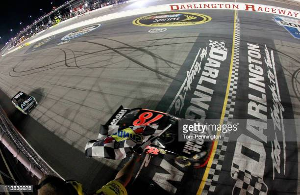 Regan Smith driver of the Furniture Row Companies Chevrolet crosses the finish line to win the NASCAR Sprint Cup Series SHOWTIME Southern 500 at...